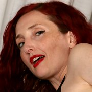 Sultry Redhead with Zinnia Blue