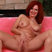 Mature Redhead Slut Shows Her Pussy And Tits with Andi James