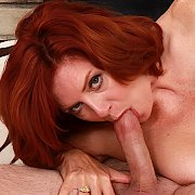 Redheaded Mature Slut Enjoys A Hard Cock with Andi James