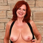 Redheaded Mature Slut Gets Naked with Andi James