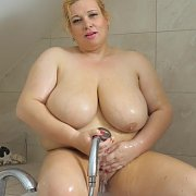 Showering Her Mature Breasts with Marla