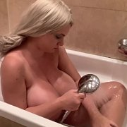 Soaping Up Her Luscious Large Breasts with Kitty Cute