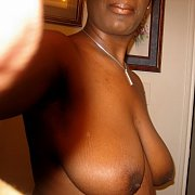 Topless Photos Of A Sexy Black Babe With Big Tits